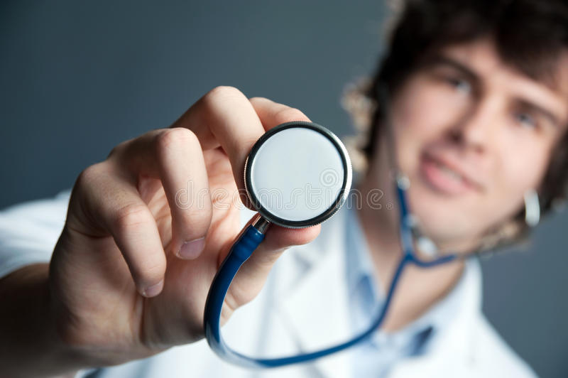 Doctor with stethoscope. An image of a young doctor with a stethoscope royalty free stock image