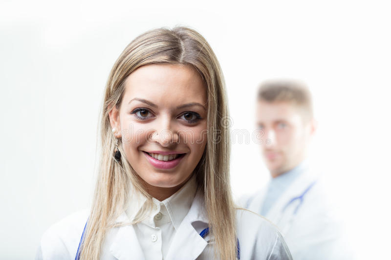 Doctor with stethoscope around his neck smiling at the camera royalty free stock images