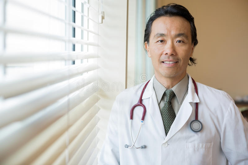 Doctor With Stethoscope Around Neck In Hospital royalty free stock photos