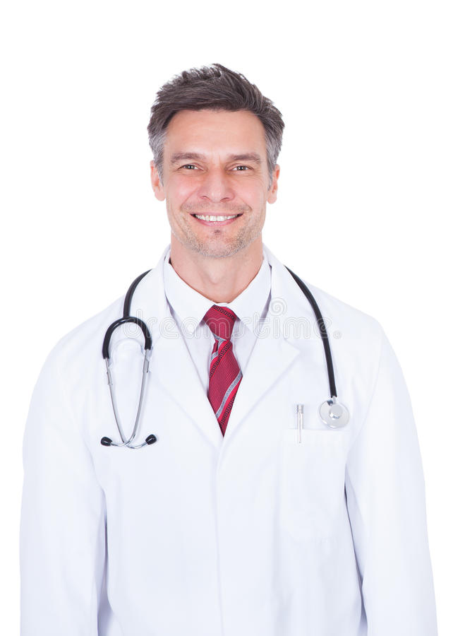 Doctor with stethoscope around neck over white background royalty free stock photography