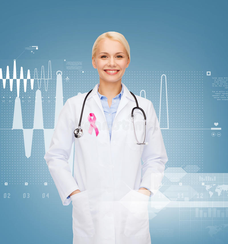 Doctor with stethoscope, cancer awareness ribbon. Healthcare and medicine concept - smiling female doctor with stethoscope and pink cancer awareness ribbon over stock photos