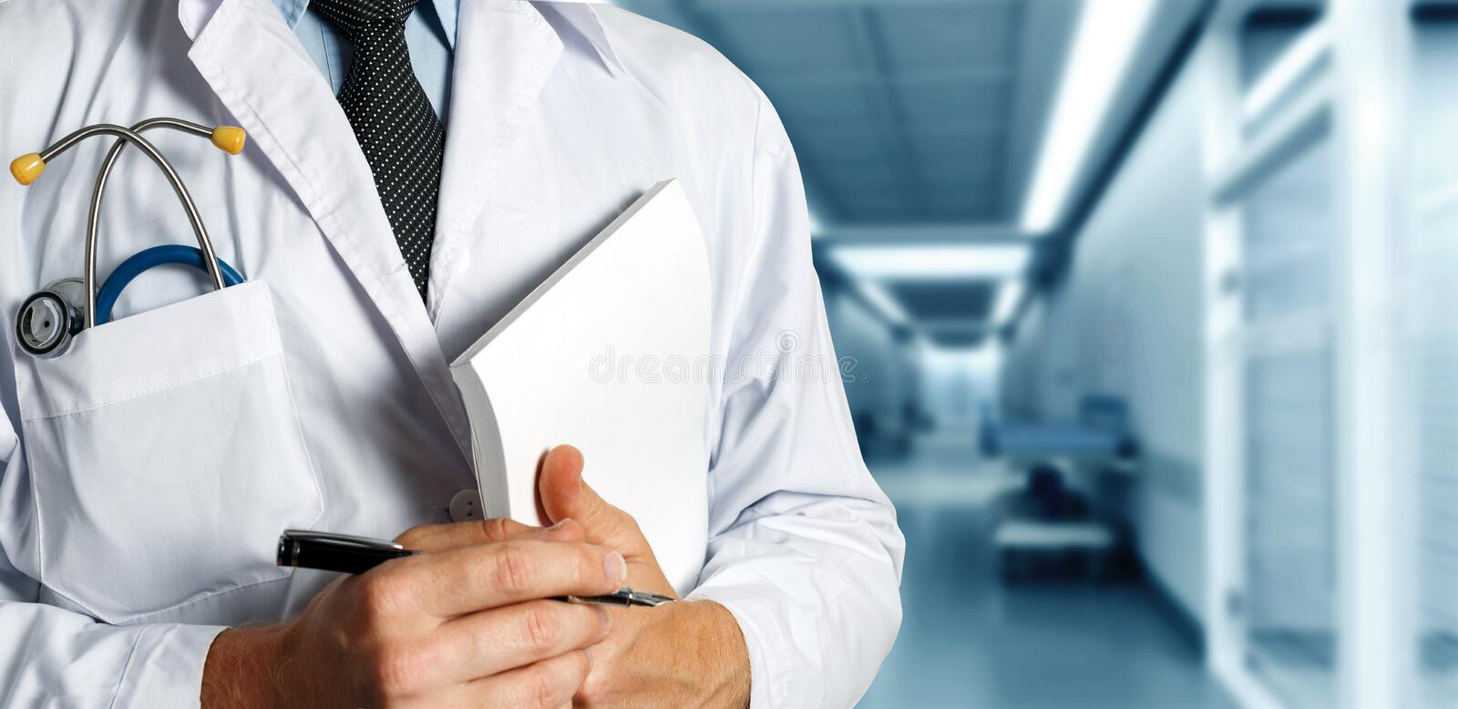 Doctor With Stethoscope Keeps Medical Journal. Healthcare Medicine Concept. Closeup, Doctor In White Coat With Stethoscope Holds Pen And Medical Documents In His royalty free stock photos