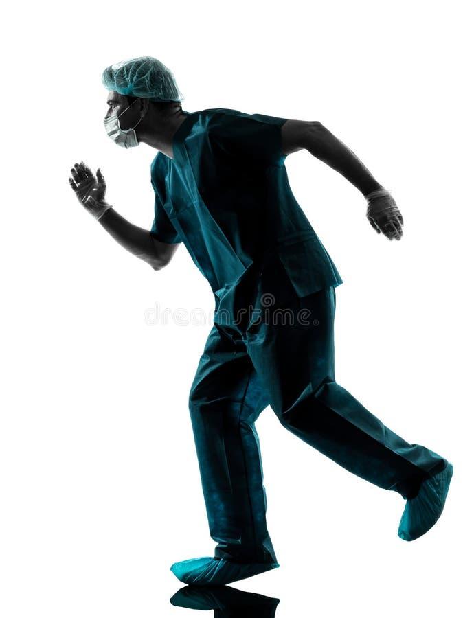 Doctor surgeon man running urgency silhouette royalty free stock photos