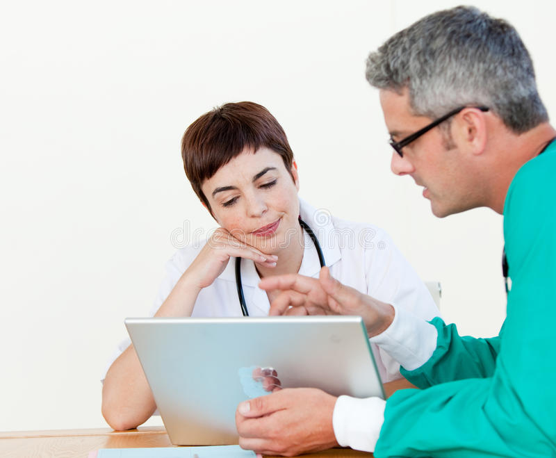 Doctor and surgeon at a meeting stock photo
