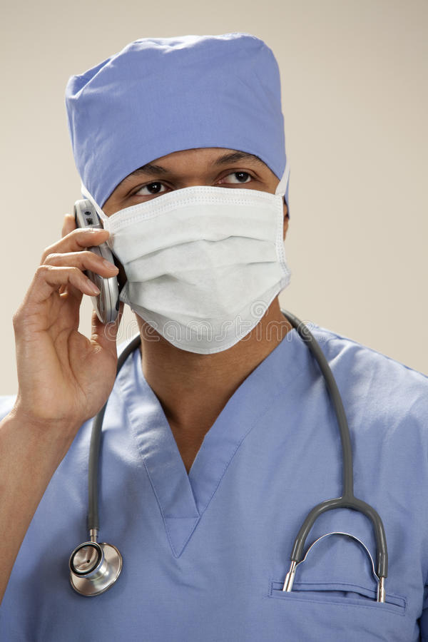 Download Doctor In Surgical Mask On The Phone Stock Image - Image: 19156347