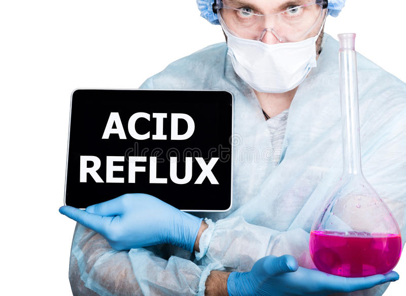 Doctor in surgical uniform, holding pink flask and digital tablet pc with acid reflux sign. internet technology and royalty free stock image