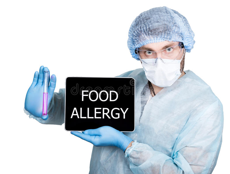 Doctor in surgical uniform, holding test tube and digital tablet pc with food allergy sign. internet technology and stock photos