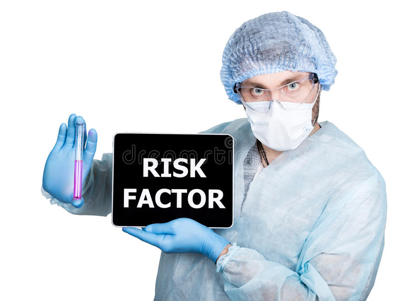 Doctor in surgical uniform, holding test tube and digital tablet pc with risk factor sign. internet technology and stock image