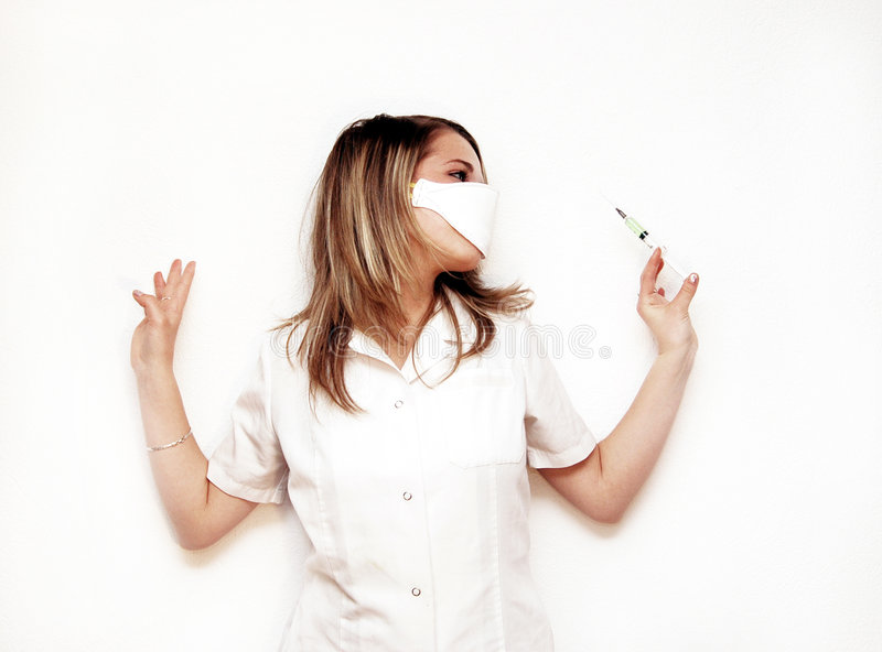 Doctor with syringe. Photo of a doctor with seringe stock photo