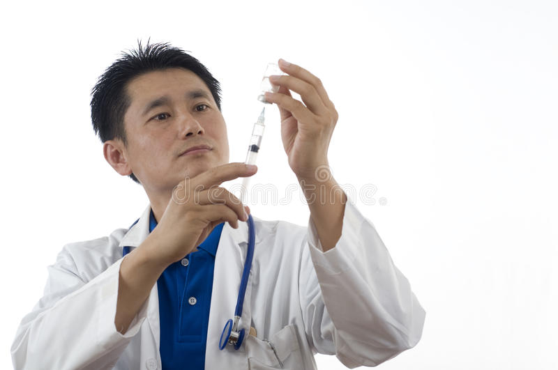 Doctor With Syringe And Medical Vial Royalty Free Stock Photo