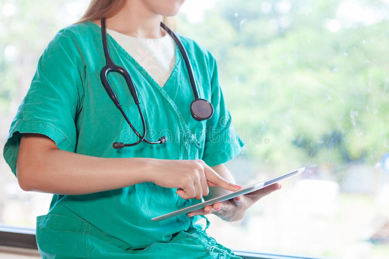 Doctor with tablet. stock images