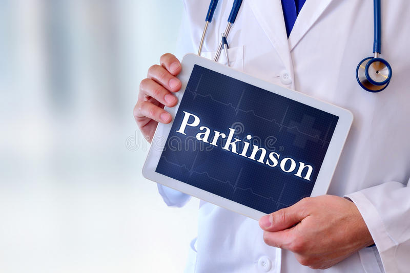 Doctor with tablet with parkinson message. Caucasian general doctor with tablet with parkinson message. Front position half body without head. Horizontal royalty free stock photos