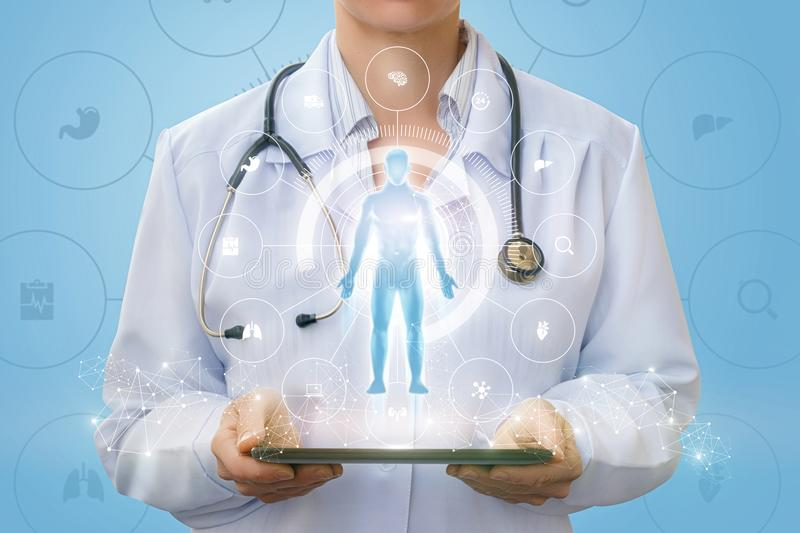 Doctor on the tablet shows a hologram of a man . stock photos