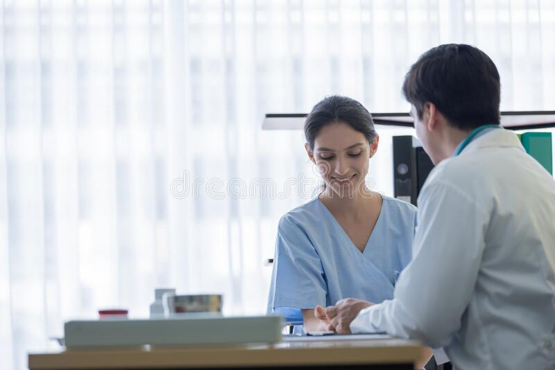 A doctor take care of sick patient woman at the hospital or medical clinic royalty free stock photos
