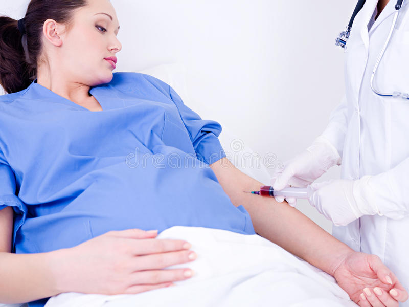 Doctor Takes Blood At The Pregnant Woman Stock Images