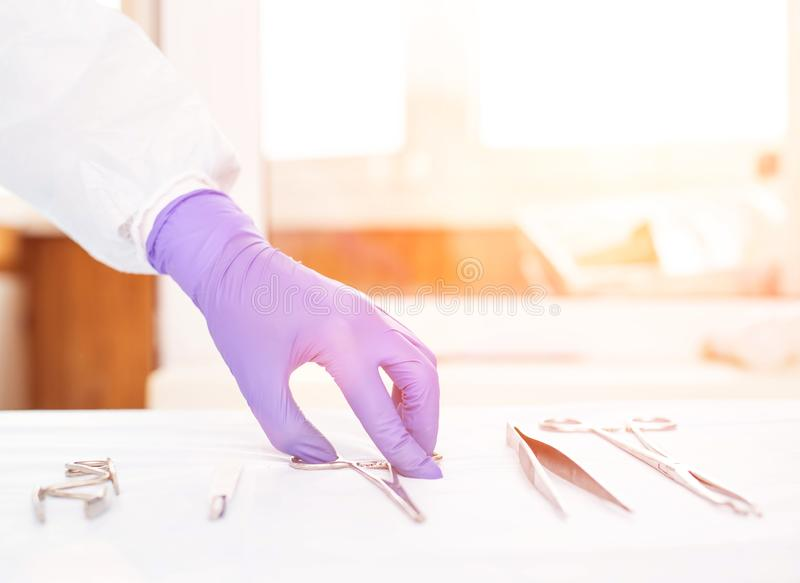 Doctor takes medical instruments from the table for the concept of transplantation of human organs and tissues, transplantology stock images