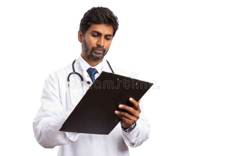 Doctor taking notes on clipboard royalty free stock photography