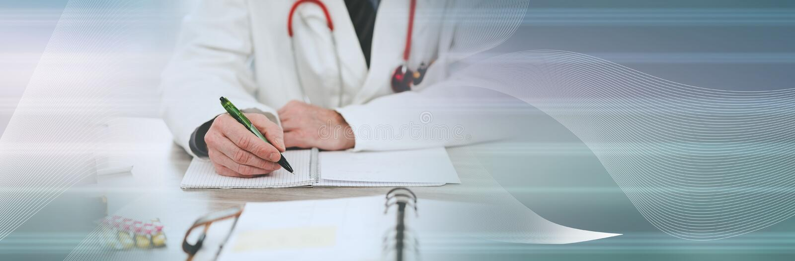 Doctor taking notes; panoramic banner. Doctor sitting at desk and taking notes; panoramic banner stock photos