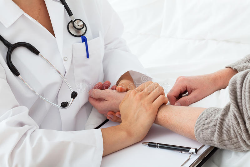 A doctor taking the pulse stock photo