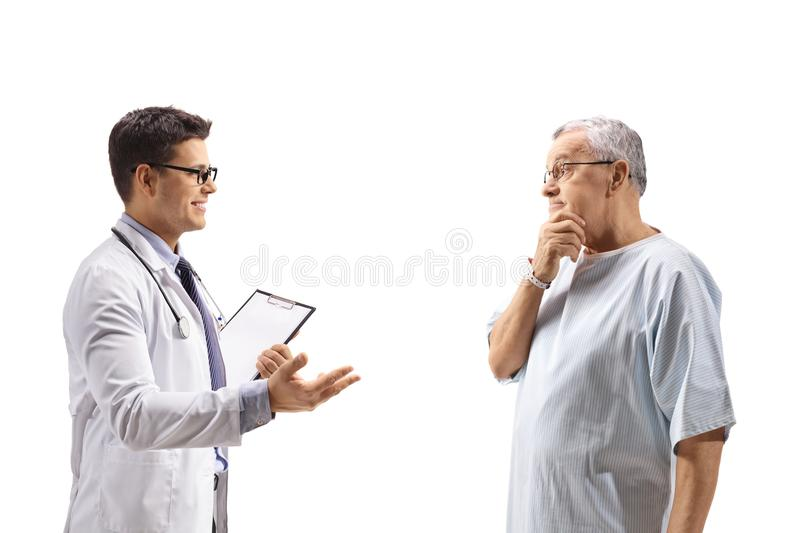 Doctor talking with a concerned elderly patient stock photos