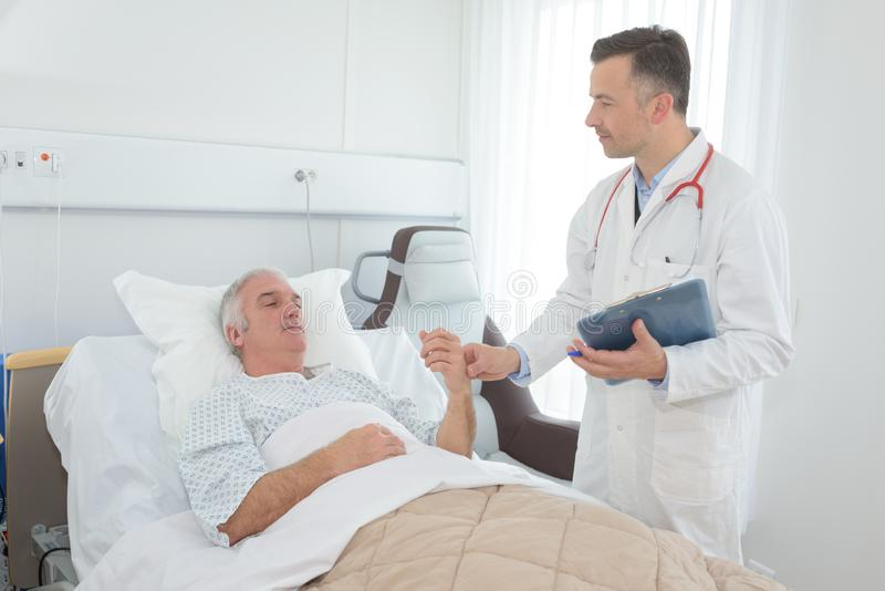 Doctor talking with old patient royalty free stock photos