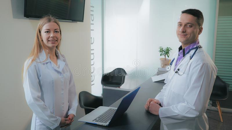 Staff in hospital have conversation. stock photography