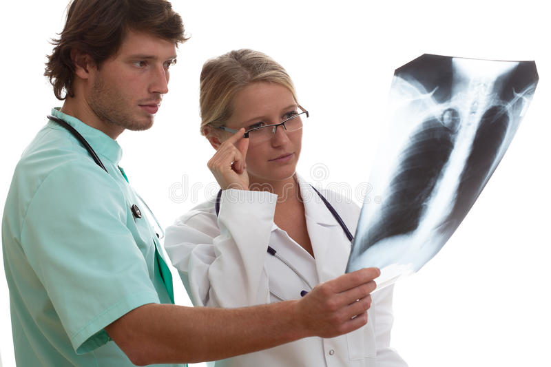 Radiologist showing x-ray to another doctor royalty free stock photos