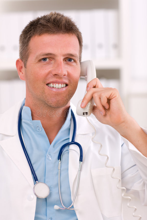 Doctor talking on phone royalty free stock image