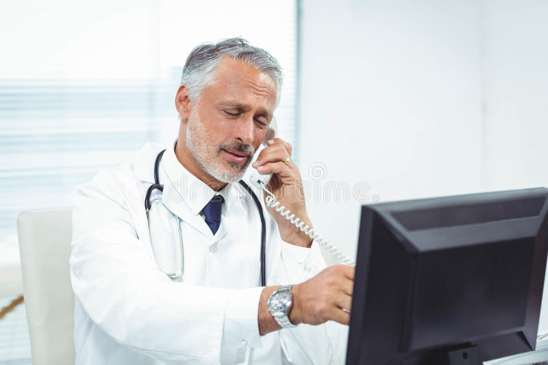 Doctor talking on phone. In clinic stock images
