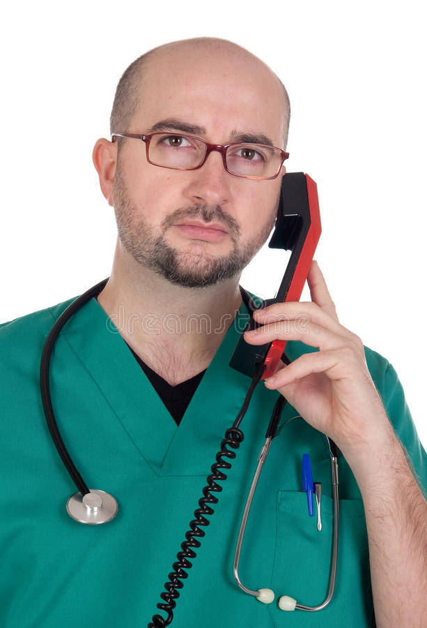 Doctor talking on a red phone royalty free stock photos