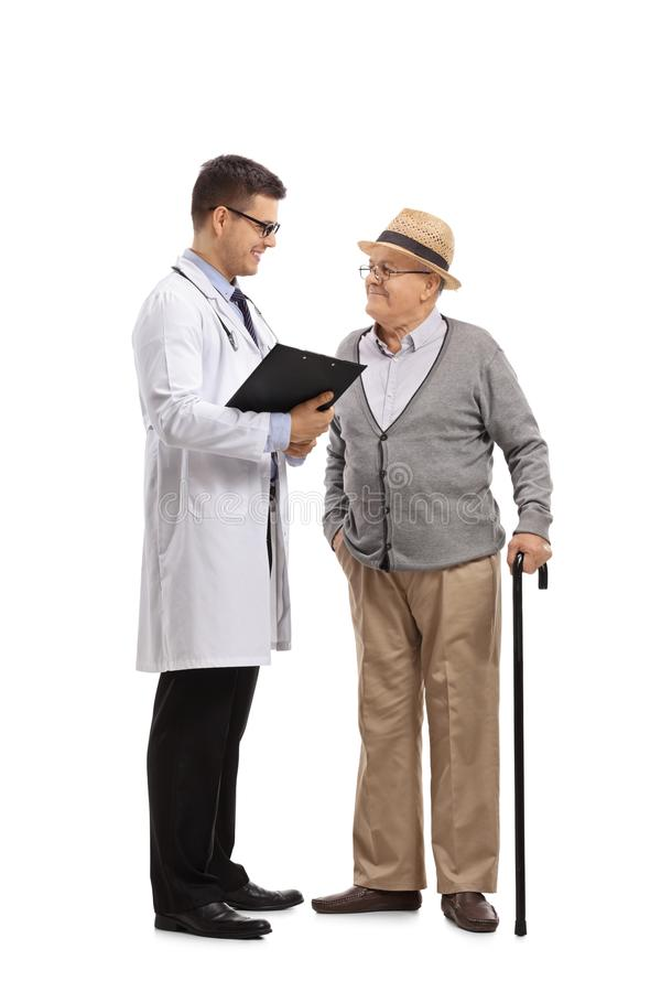 Doctor talking to an elderly patient royalty free stock images