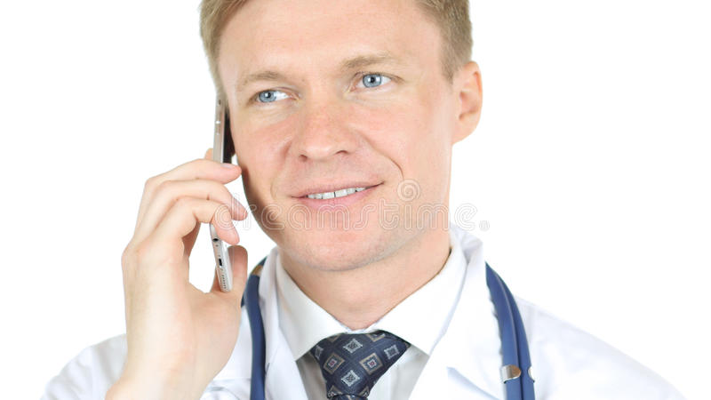 Doctor talking to his patient on the phone. High quality stock photography
