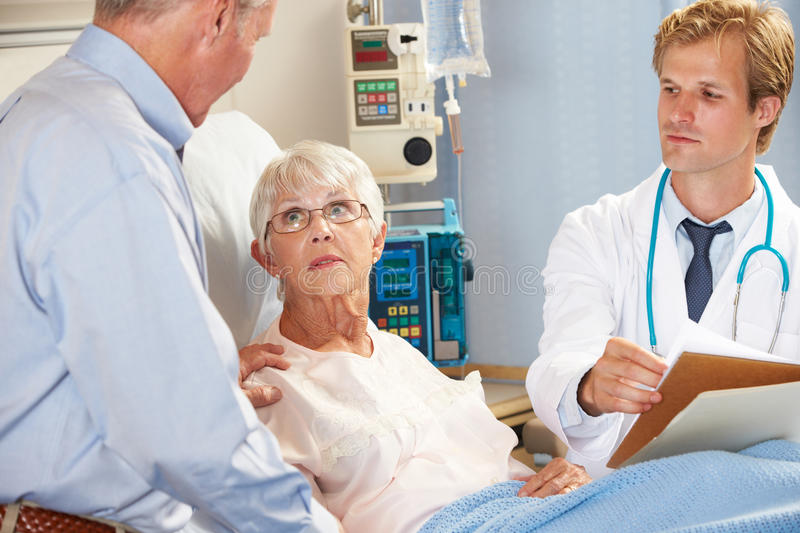 Download Doctor Talking To Senior Couple On Ward Stock Photo - Image: 28705376