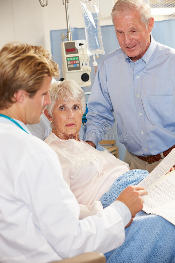 Download Doctor Talking To Senior Couple On Ward Stock Image - Image: 28705397