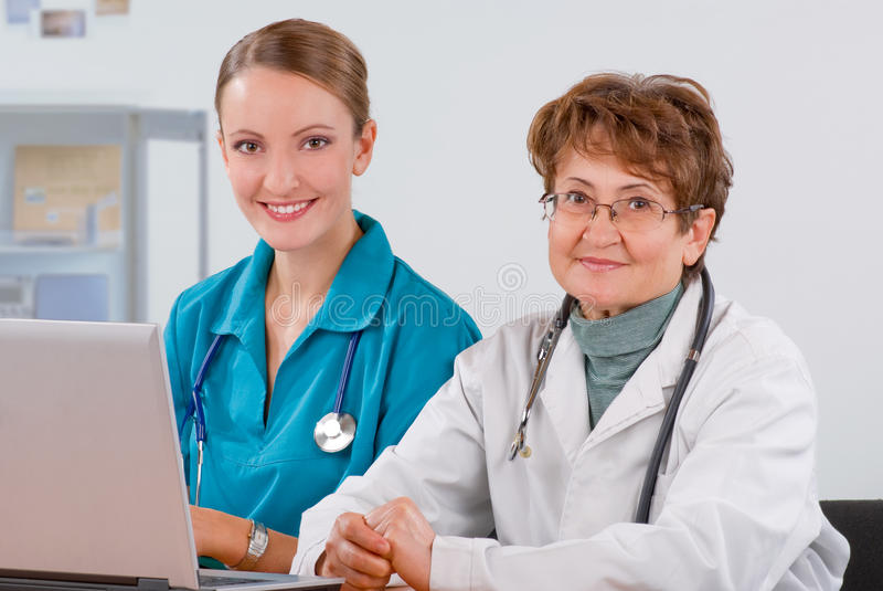 A doctor teaches a student stock photography