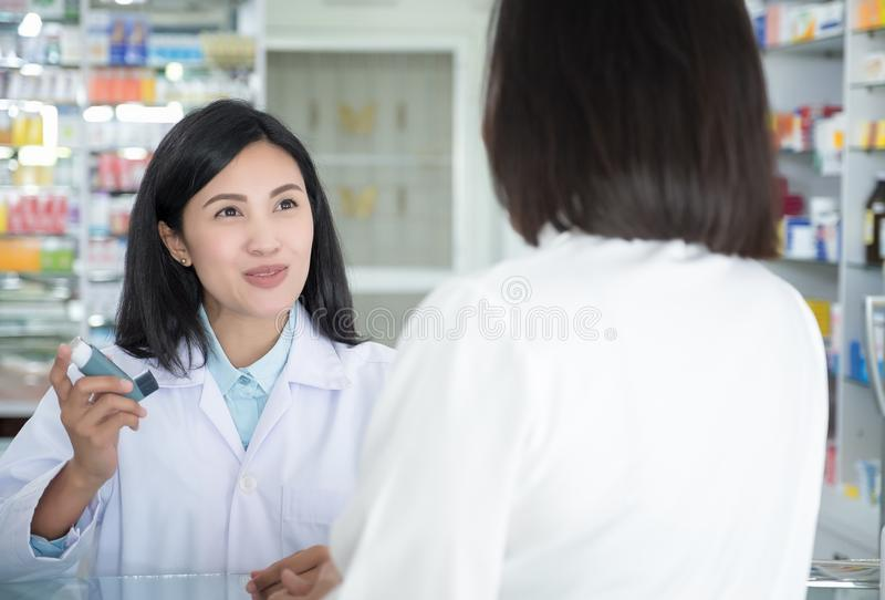 Doctor test and teach spray and checking for a patient`s mouth stock images