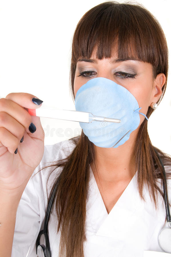 Doctor with thermometer and protective mask flu royalty free stock photos