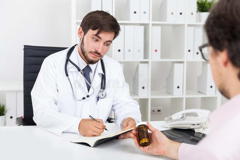 Doctor thinking about new drug stock images