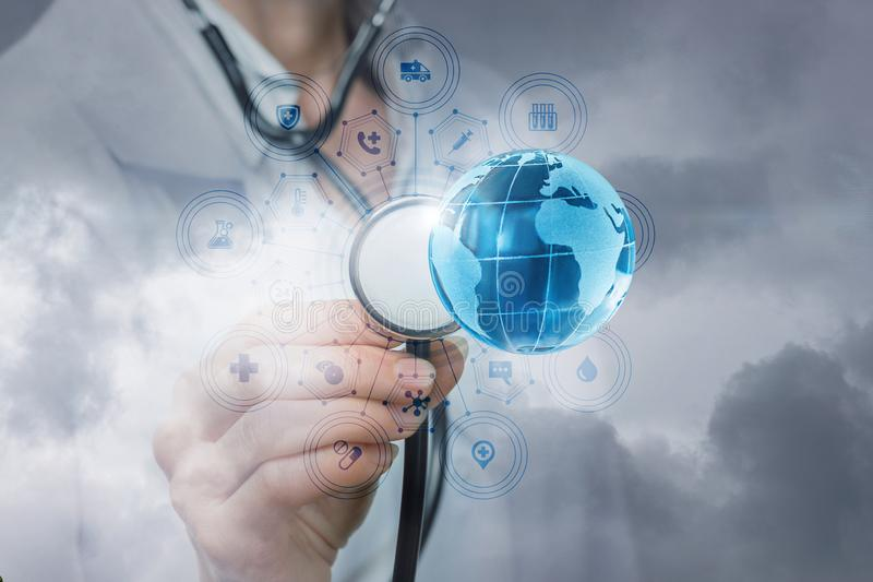 A doctor is touching a bright global map stock photos