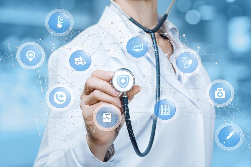 A doctor is touching a digital scheme of wireless connections containing small spheres with medical icons inside.The concept is royalty free stock photography