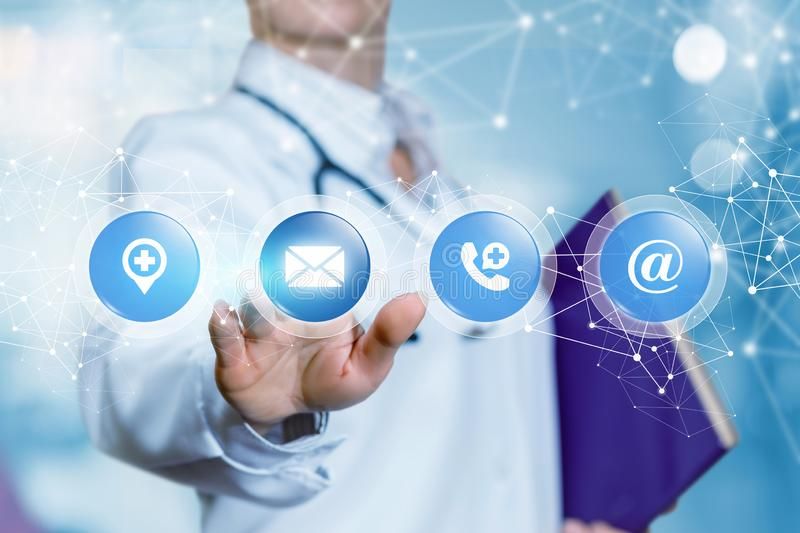 A doctor is touching the icons with communication and interaction symbols inside . stock photos