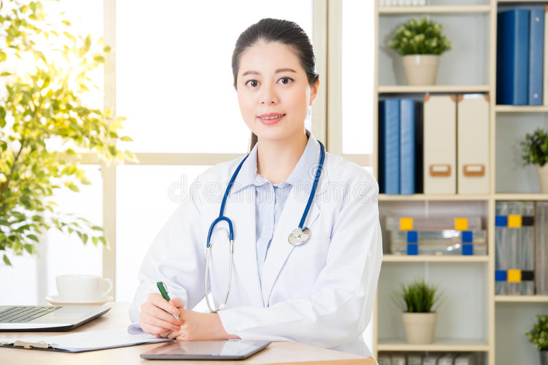 Doctor using digital tablet to recording patient`s medical case royalty free stock photography