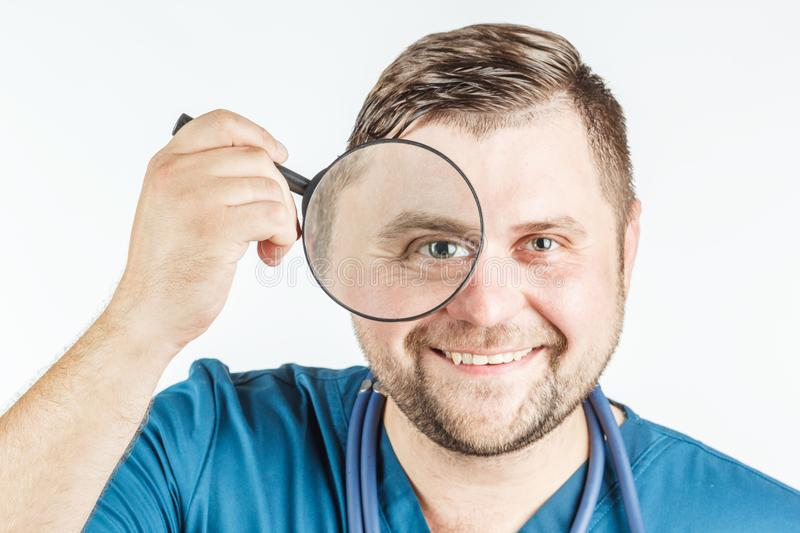 Doctor using a magnifying glass on a white background. stock image