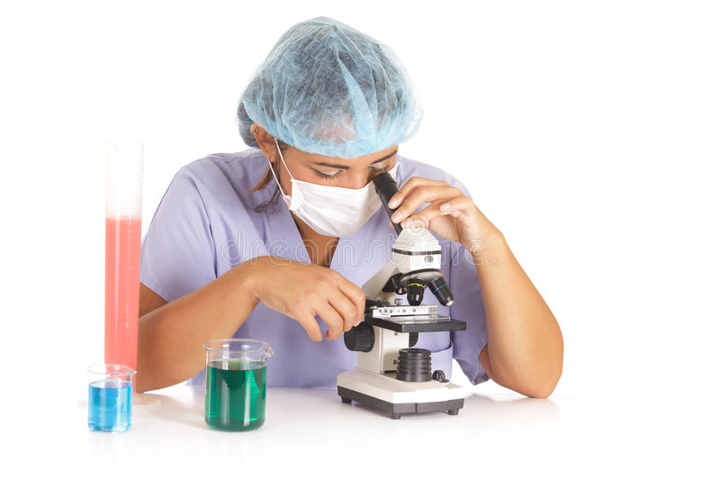 Doctor using microscope. Young doctor or researcher watching through microscope on white royalty free stock photo