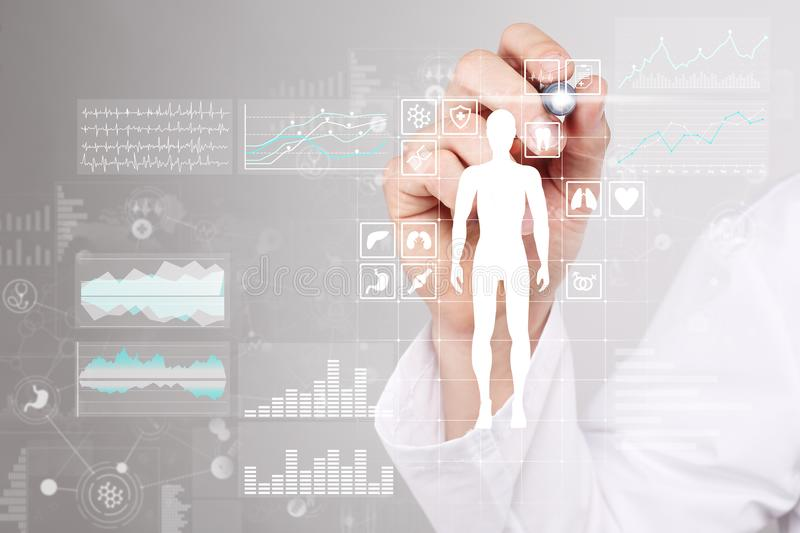 Doctor using modern computer with Medical record diagram on virtual screen concept. Health monitoring application. stock image