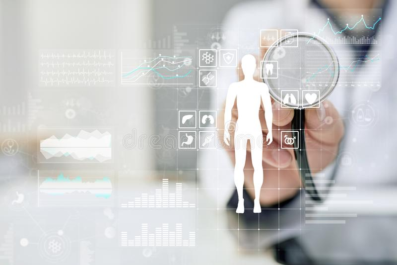 Doctor using modern computer with Medical record diagram on virtual screen concept. Health monitoring application. stock photo