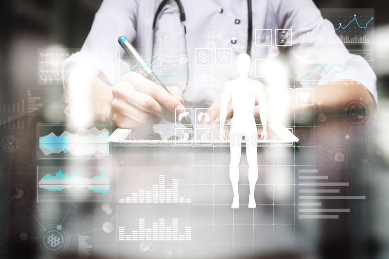 Doctor using modern computer with Medical record diagram on virtual screen concept. Health monitoring application. Doctor using modern computer with Medical stock image