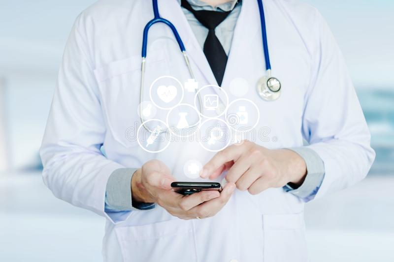 Doctor using smartphone and health care icon on background of Ho. Spital ward stock images