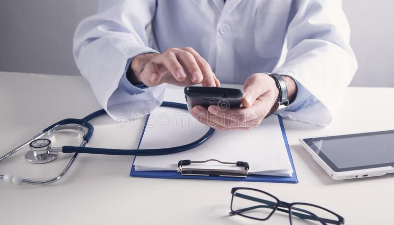 Doctor using smartphone. Medicine and Healthcare concept stock photos