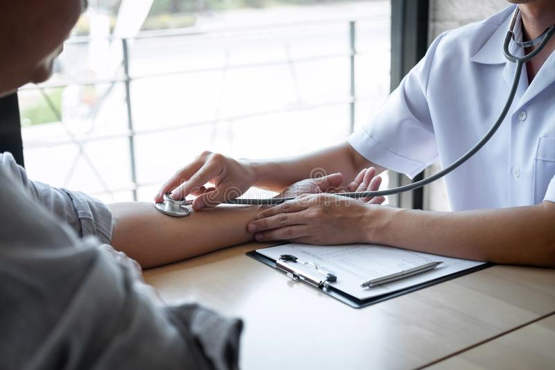 Doctor using a stethoscope checking patient with examining, presenting results symptom and recommend treatment method, Healthcare stock photography